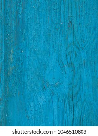 Blue wooden background. Painted wood board surface with cracks. Bright abstract background with place for text. Closeup view.