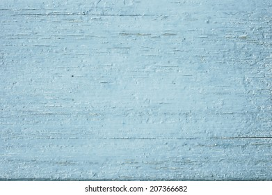 blue wooden background with peeling paint