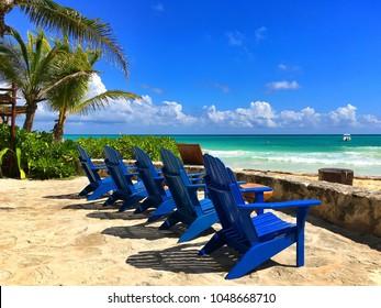 Blue wooden beach chairs on the empty beach,Yucatan,Mexico