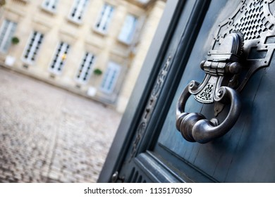 Blue wooden door and bronze knocker