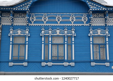 Blue wooden house with carved windows in Syzran city (Russia). Russian style in architecture