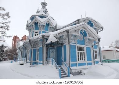Blue wooden Russian-German house in Tomsk city (Russia). Russian style in architecture