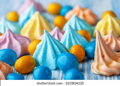 Blue wooden table full of candies, lollipops, cookies and sweet unhealthy food