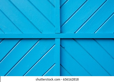 A blue wooden wall with quadrants and diagonal patterns.
