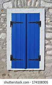 Blue wooden window shutter on an old stone house at south Pelion, Greece