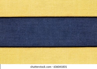 Blue and yellow checkered canvas fabric material. Empty copy space background.