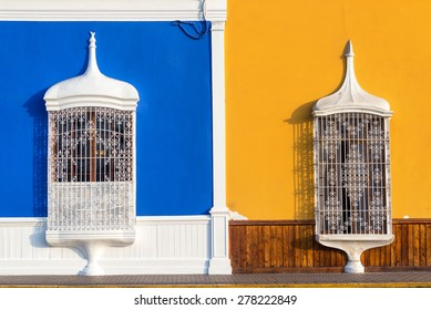 Blue and yellow colonial architecture in the historic center of Trujillo, Peru