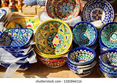 Blue and yellow decorative ceramic plates on street market in the city of Bukhara, Uzbekistan