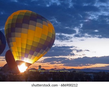 Blue, Yellow, and Green Hot Air Balloon at Sunset