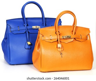 Blue and yellow handbags from genuine leather isolated on white background