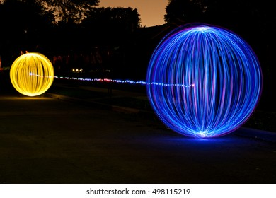 Blue and Yellow Orbs connect with light Abstract Light Painting at night - Light Art Photography