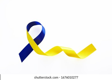 Blue and yellow ribbon on white background. World down syndrome day. Awareness ribbon.