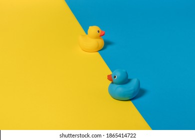 Blue and yellow rubber duck with blue and yellow background. Copy space. Minimal opposite concept