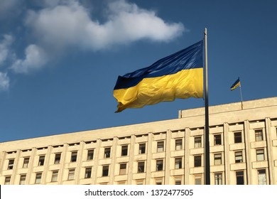 Blue and yellow Ukrainian national flag on a flagpole near the Central election commission of Ukraine. The symbol of presidential ballot and poll in Ukraine 2019