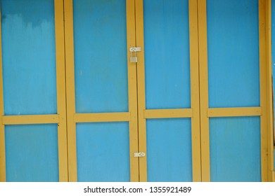 blue and yellow wooden doors