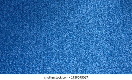 Blue yoga rubber mat surface