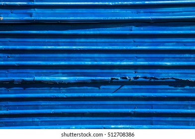 Blue zinc fence and shadow to background