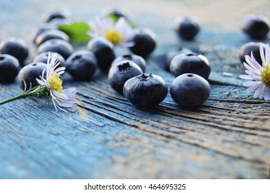 Blueberries background. Blueberry border design. Ripe and juicy fresh picked bilberries close up. Copyspace for your text. Freshly picked blueberries.