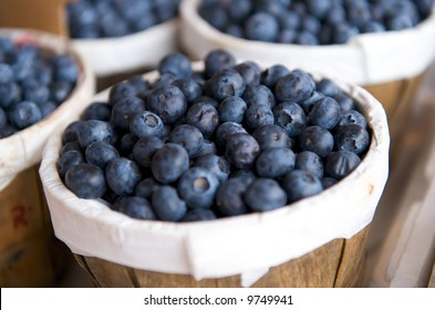 Blueberries in a basket on a market stall