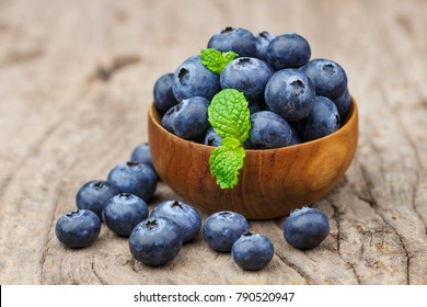 Blueberries in a bowl on a wooden table, Healthy eating and nutrition concept