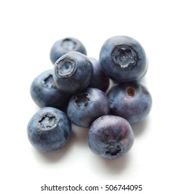 Blueberries (cyanococcus) isolated on white background