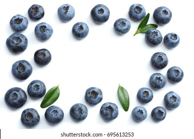 blueberries with green leaf isolated on white background.