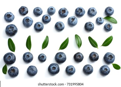 blueberries with green leaf isolated on white background. top view