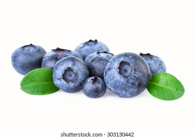 Blueberries with green leafs isolated on white