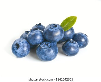 Blueberries isolated on white background. Extreme close up view of heap blueberry berries with green leaf. Isolated on white with clipping path.