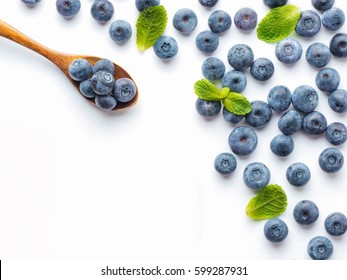 Blueberries isolated on white background. Blueberry border design. Ripe and juicy fresh picked bilberries close up. Copyspace. Top view or flat lay
