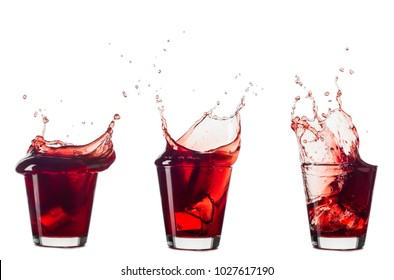 blueberries juice splash out of glass isolated on white background