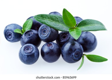 Blueberries with leaves isolated on white background