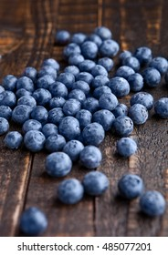 Blueberries on grunge wooden kitchen board. Natural healthy food. Still life photography