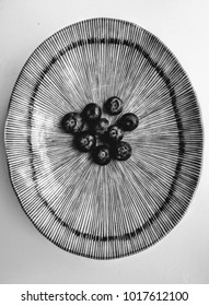 blueberries on a plate, black and white