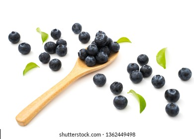 blueberries on spoon isolated on white background