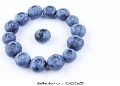 Blueberries on white background, blueberry berries isolated, blue berries close-up, blank for designer, vegetarian food
