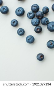 blueberries on white background with empty white space