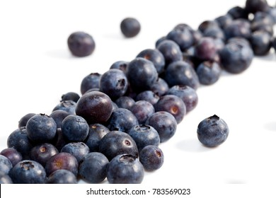 Blueberries on white background.  Macro shot with focus of front berries.