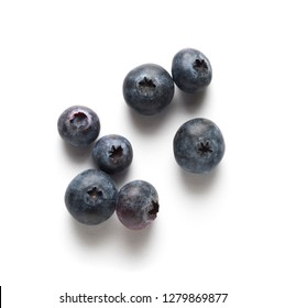 blueberries on white table, isolated with shadow