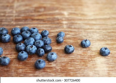 blueberries on wood background