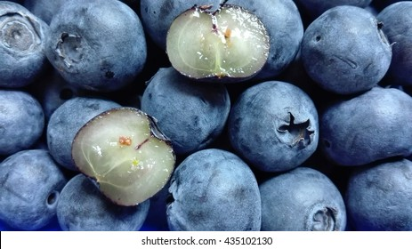 Blueberries -  The picture shows blueberries, one of which is cut in half.