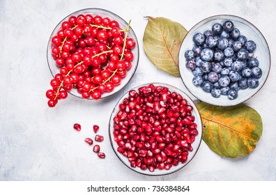 Blueberries, pomegranate and redcurrant top view.Healthy antioxidant food.