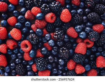 blueberries, raspberries and black berries shot top down - Shutterstock ID 256957624