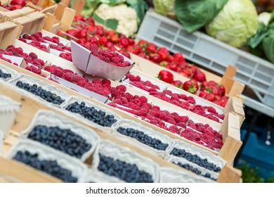 Blueberries, raspberries and Strawberries on a market stall