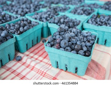Blueberries for sale at a farmers' market.