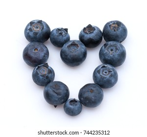 Blueberries shaped like a heart on white background. Calgary, Alberta, Canada.