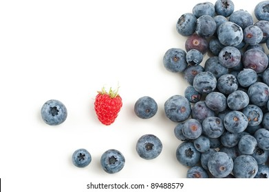 Blueberries with a single raspberry