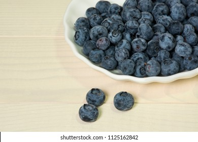 Blueberries summer berry on wooden table. Vitamin C, E, P, PP, B carotene flavonoids ascorbic acid. Organic fresh antioxidant food