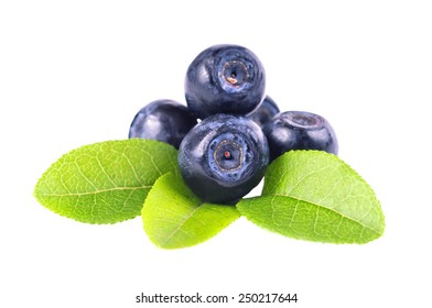 Blueberries and two leaves isolated on white background