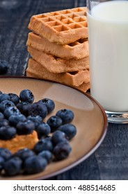 Blueberries  and waffles on plate with milk glass. Still life